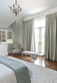These beautiful custom silk drapes match the color of the walls in this smoothing bedroom setting.