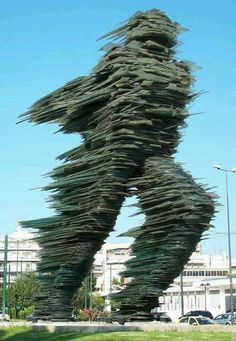 "Amazing glass statue called ""The Runner"" in Athens Greece"