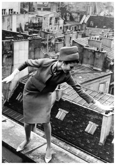 Gloria Friedrich wearing suit by Balmain photographed by Rico Puhlmann high on the rooftops of Paris for Stern magazine, March 1963