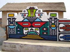 The Ndebele art of South Africa brings vibrant color to walls and homes.