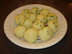 <b>Kartoffel Klösse (1)</b>: German cuisine Klöße (singular: Kloß) or Kartoffelknödel, in Germany and Austria called Knödel(n) are big round poached or boiled potato or bread dumplings, made without yeast, often filled. Knödel make an excellent side-dish and go well with all types of meat recipes.