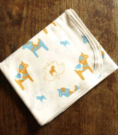 Swedish Dala Horses in Blue and Yellow Baby Blanket in Organic Jersey Cotton