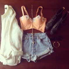 Bustier, sweater, shorts, boots and jewelry.