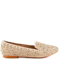 Give your closet a jump start with this edgy flat by Steve Madden.  The Graanite features a beige suede upper with rocker chic studs and stones.  A simple loafer shape will deliver everyday style with a touch of bling.
