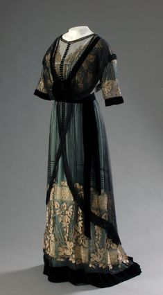 One of many beautiful dress was made under the time of Belle Époque. The dress was made from net, gold, satin, velvet, embroidery, metallic. Unknown designer 1910 info and image from http://centuries-sewing.tumblr.com/page/2