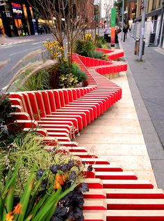 """WMBstudio has designed and installed 'parked bench'– a temporary parklet located on a busy street in the London Bridge area. The portable micro-park replaces [a few] parking spaces, with the aim of providing urban greening, public seating, and to raise awareness of air quality issues"" in London, England. (2015) - photo from designboom"