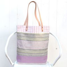 "One-off patchwork linen tote.  Only one available.* Yarn dye linen * 4-5 oz vegetable tan leather strap handles. * Fully lined with cotton fabric. * 2 large inner pockets.* Bag size: 14"" width X 15.5"" height X 4"" depth * Strap drop: 9.5"""