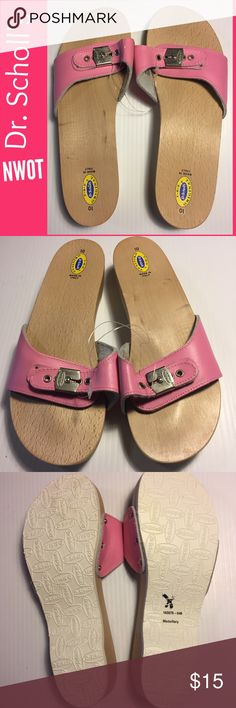 """NWOT Original Dr. Scholl's size 10 Pink Leather NWOT New Without Tags - the original Dr. Scholl's wooden soles slide sandals. Pink leather, silver toned hardware, impeccably clean creamy ivory contoured soles. Smooth natural wooden footbed, durable non-slip sole, 1.5"""" heel, 3/4"""" platform. Adjustable with distinctive Dr. Scholl's buckle. Classic yet modern! Great iconic shoe for an amazing price. Note shoes are held together as a pair w/clear plastic strap applied by retail store. Has never…"""