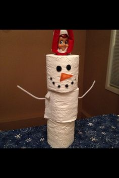 Elf on the Shelf in a snowman made of toilet paper rolls....
