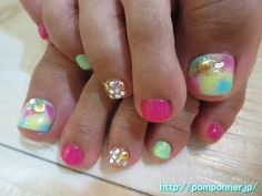 トロピカルカラーなフットネイル  tropical foot nail color. Thumb I decorated the base stone and shell parts, studs to tie dye pattern. Middle finger was filled Stone, studs, pearl, shell parts in clear base.
