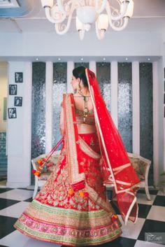Red bridal lehenga with orange blouse
