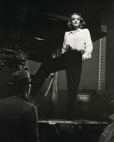 "Marlene Dietrich - inspires women to start wearing slacks. In 1930 film ""Morocco""."