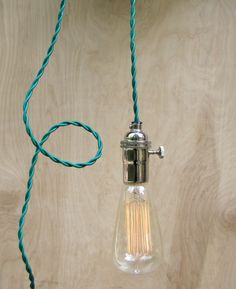Contemporary Green Pendant Lighting / Modern Hanging Edison Light / Bare Bulb Minimalist Lamp. $75.00, via Etsy.