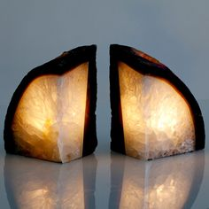 Bookend Candle Holders Gray  by Dara Ettinger    These Bookend Candle Holders are nature's reminder to not judge a book by its cover. Beneath the agate geode's rugged stone surface is a vibrant interior rich with natural complexity. With space for one votive candle deeply—and safely—concealed deep within the rock, these bookends will keep your books in place and your space illuminated.