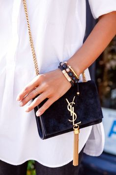 A look for a working day. For a work meeting. White blouse with a black YSL purse and some bracelets. @andwhatelse