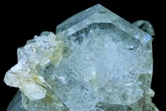 Beryl,Muscovite  Aggregate of thick tabular crystals very rich in forms. They are transparent, extraordinarily bright and have a very uniform sky-blue color. They are on matrix with aggregates of very Sharp small Muscovite crystals. Photo Copyright ©JordiFabre