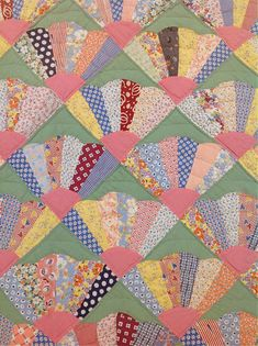 The top of this vintage dresden fan quilt was stitched in the 1930s. Just look at those colours and fabrics!   #quilts #quilting #dresdenfanquilt #vintage #sewing #patchwork #crafts #vintagequilts