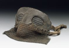"""Protective mask, leather and chain mail, worn by tank crews, probably British, 1917-1918 Tank drivers wore """"medieval"""" head gear. These were used to protect their faces from shrapnel. The chain mail helped protect their faces from the pieces of hot metal that were hitting the tanks."""
