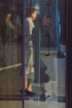 Saul Leiter - Walking, 1956 - Howard Greenberg Gallery