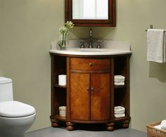 """The Xylem 37"""" Carlton Corner Bathroom Vanity Stained Cherry Veneer Finish radius design with open side shelves betrays the amount of storage that the Carlton has. http://www.listvanities.com/vintage-bathroom-vanities.html  It's two doors open to additional bath storage and reveal a concealed inner drawer for storing smaller items. A beautiful corner vanity, linen tower and dual cleated mirror all with stained cherry veneer, compliment the Carlton."""