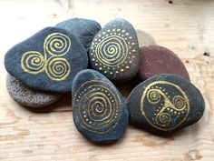 Hand painted celtic stones, celtic gold stones, celtic spirals, cetic designs on stones  by AmyRoseBudd on Etsy https://www.etsy.com/listing/234059223/hand-painted-celtic-stones-celtic-gold