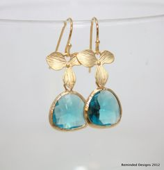 Awe Struck- Gold orchid and gold framed glass stone earrings. $25.00, via Etsy.