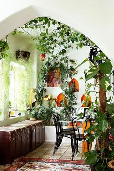 What a perfect room with its fabulous light and greenery and those awesome orange wall nooks.... --Pia (Yellow Orange and Green on White  La Boheme_