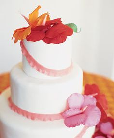 Wedding Color Scheme: Red Hot. -- This classic white three-tier rolled fondant wedding cake with white chocolate ruffles in pink touts a touch of the tropics with its sugar-paste hibiscus flowers. Cake, $450, serves 50, Cheryl Kleinman Cakes. -- I love hibiscus flowers!