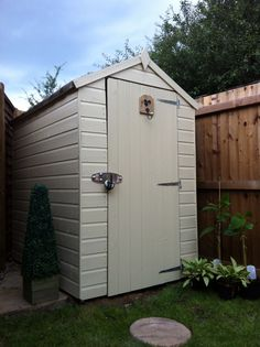Shed makeover complete! Painted and lovely! (I used Cuprinol Garden Shades in Country Cream) Painted Garden Sheds, Garden Fence Paint, Painted Shed, Cuprinol Garden Shades, Shed Makeover, Shed Colours, Garden Stones, Shed Plans, Shade Garden
