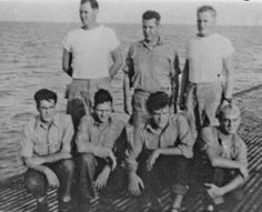 FLIER survivors on the deck of REDFIN shortly after their rescue. From left in the first row are James Russo, Wesley Miller, Earl Baumgart and Arthur G. Howell. From left in the back row are Lt. Jim Liddell, Capt. John Crowley and Ensign Alvin Jacobson. Don Tremaine was in sickbay at the time the picture was taken.