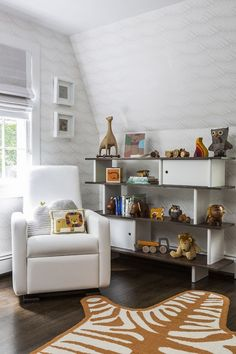 Dylan's room by Sissy + Marley features the Monte Design Grano Glider Recliner in white bonded leather and Oeuf furniture. Photography by Marco Ricca
