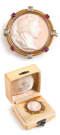 Fabergé, Erik Kollin - An antique jeweled gold cameo brooch, St. Petersburg, late 19th century. Circular, the pink and white shell carved with a profile bust of a classical maiden, swivel-set within a corded frame set with circular-cut rubies and diamonds, 56 standard, scratched inventory number, diameter 4 cm. #Faberge #antique #brooch