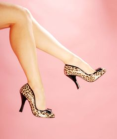 Smitten Pump in Cheetah Print from Pinup Couture Shoes - With great pleasure we present Pinup Couture shoes!  Partnering up with the same company that brought you the fabulous Bordello line, weve worked to design a line of beautiful and affordable vintage-inspired shoes that will live in perfect harmony with the rest of your PUG wardrobe.  The Smitten is a great retro basic with round toe, bow detail, and a perfect curved 4 heel.  Cheetah print with black trim.  A PUG Favorite!