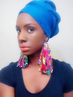 """These Ankara fabric earrings are so fabulous you are sure to be the center of attention. They are approximately 8.5"""". Go ahead... Be daring... Be fabulous!!!"""