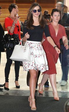 Miranda Kerr steps out in Sydney in a floral skirt and basic black top.