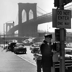 A police officer makes a call at the Brooklyn Bridge in 1955