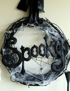 Spooky wreath. Spray paint grape vine wreath, add fake spider web. #Halloween