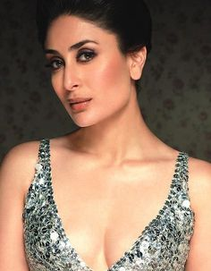 Kareena Kapoor looks absoluetly hot in this low cut dress. The actress flaunts her chiselled jawline with hair tied up. The smoky eye is adding to the effect and making the actress look absoluetly flawless. Indian Bollywood Actress, Beautiful Bollywood Actress, Most Beautiful Indian Actress, Bollywood Actors, Bollywood Celebrities, Bollywood Fashion, Beautiful Actresses, Indian Actresses, Kareena Kapoor Images