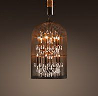 "Restoration Hardware's Vintage Birdcage Chandelier 22"":Inspired by a vintage birdcage, our reproduction juxtaposes rustic hand-wrought iron with a precision-cut faceted crystal glass pendant. Handcrafted in authentic detail and hung from a 3""-thick weathered marine rope, the cage has a hinged side door to facilitate bulb replacements."