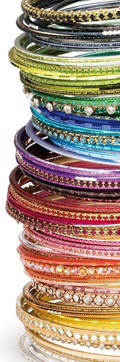 We ♥ Bangle Stacks!    Bangle stacks - An ancient tradition, a modern favourite.  What's the appeal?  A stack of bangles is a fantasia of colour, easily changeable to suit your mood and occasion.  Versatile enough for a night out, special enough for a wedding party: bangle stacks are definitely the hottest thing to have on your arm right now!    Click to read story.