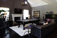 Amazing media room with gray walls, vaulted ceiling, TV over fireplace, ...