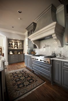 galley kitchen remodeling ideas bump up the cabinets above stove to make more room for 3716