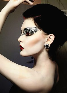 I like the contrast of white skin, red lips, and dark eye makeup. Kinda like the red contacts too!