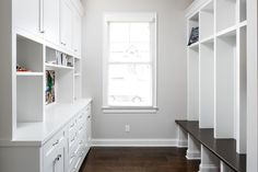 Mudroom with custom storage shelving system and cubbies. Designed and built by Ramage Company.