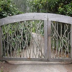 A garden gate made of re-purposed branches and twigs. Natural and lovely.