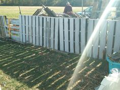 My diy pallet fence - love it! Cheap & easy