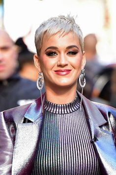 """Katy Perry revealed that chopping her long locks meant """"trying to redefine what beauty means to me."""" She said: """"Now I can't hide behind it. I wanted to know that I could still feel beautiful and love myself without it. It's fun, it's freeing, it's liberating, and I don't think that 'sexiness' and 'femininity' is just one thing—long hair. I suppose the goal is to redefine what femininity means to me."""" We think she looks gorgeous with a pixie cut."""