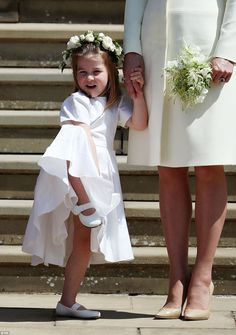 The three-year-old was in good spirits following the royal wedding, as she stood on the church's steps and waved while holding Kate's hand
