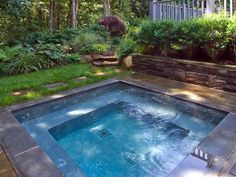 Block retaining wall~ Designer's Notes The masonry retaining wall offers additional seating around the pool for guests. Foundation plantings hide the understory of the deck and create a more private space.