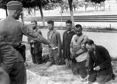 "SD officers have arrested a group of suspected Russian partisans and order them to empty their pockets. Soon after this photo was taken all five men were shot dead for their alleged ""anti-German actions,"" 15-16 July 1941."